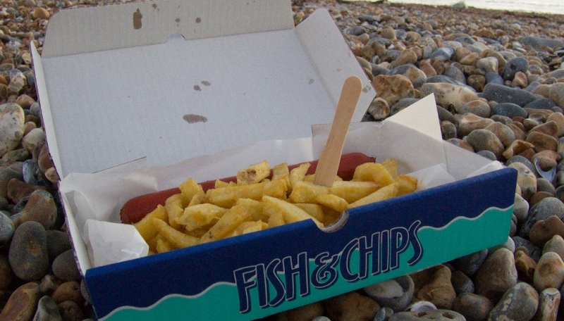 Saveloy and chips on the beach